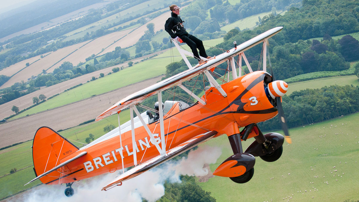 Journalist Tom Jennings from the Oxford Mail wingwalking: Press photography by Gloucestershire PR agency Alias for Fly to the Past